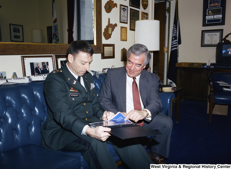 Photograph of Congressman Nick J. Rahall speaking with Military Officer Rivenburgh