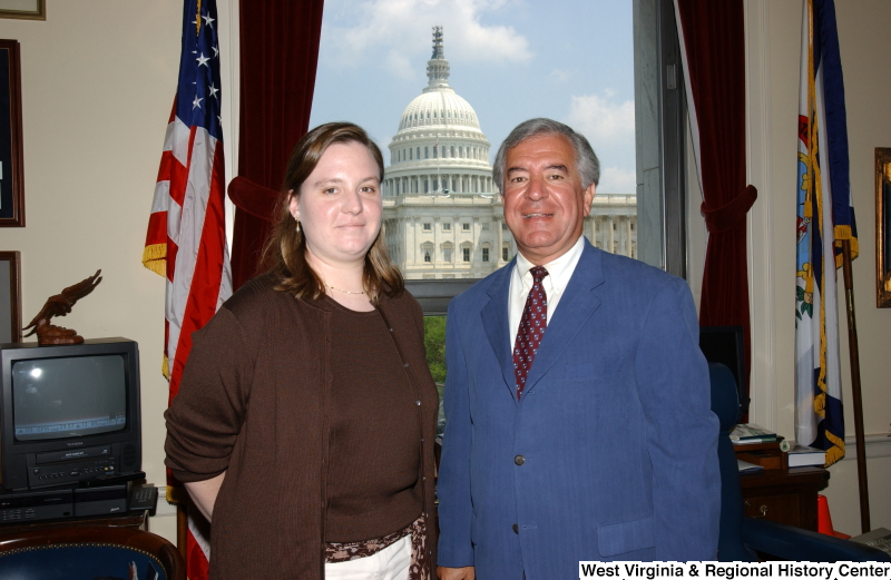 Congressman Rahall stands with an unidentified woman in his Washington office.