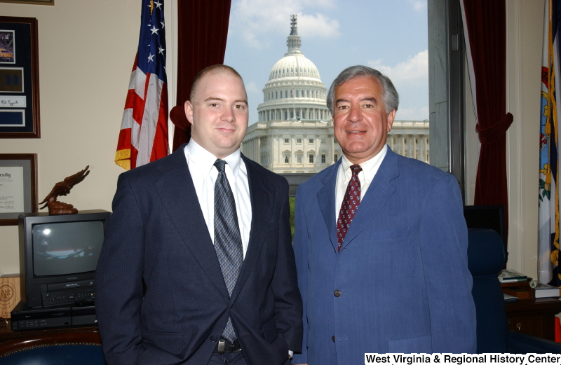 Congressman Rahall standing with an unidentified man in his Washington office.