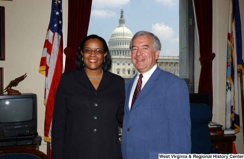 Congressman Rahall stands with a woman in his Washington office.