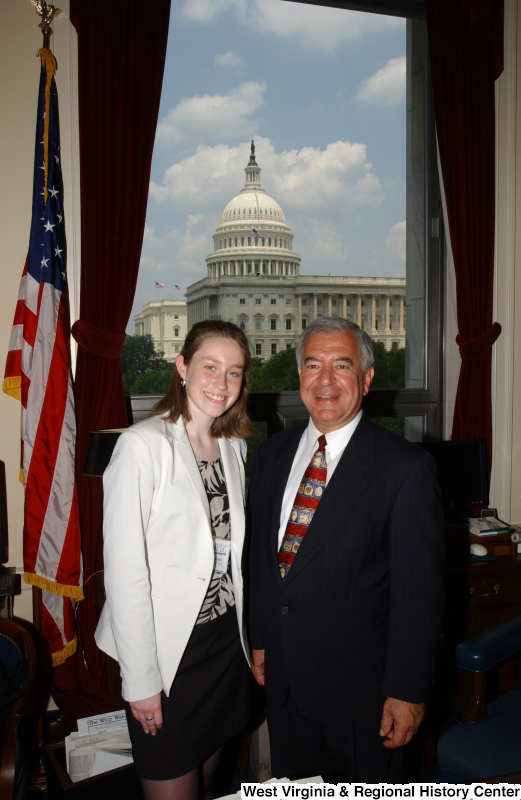 Congressman Rahall stands with a woman wearing a white sportcoat in his Washington office.