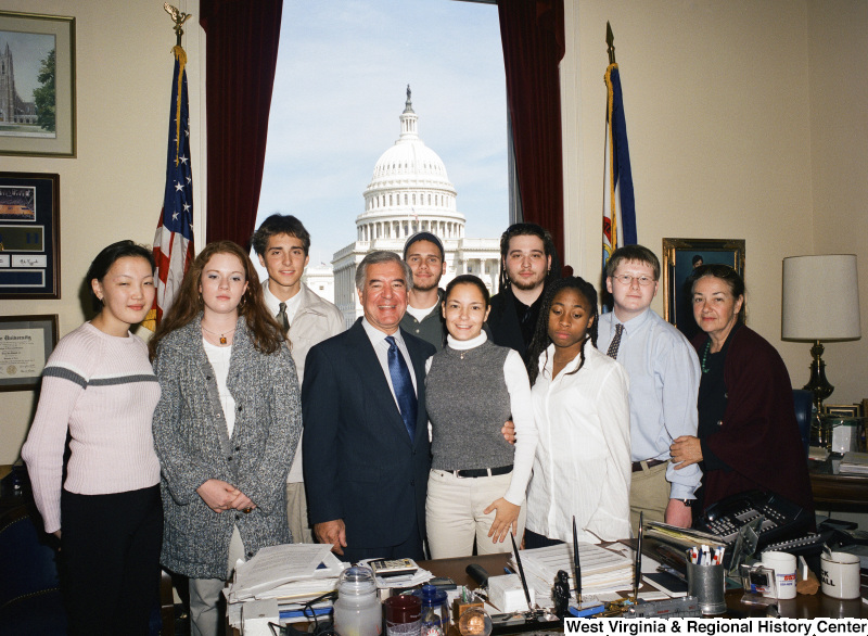 Congressman Rahall stands with nine others in his Washington office.