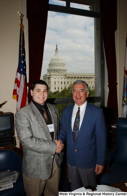 Congressman Rahall stands in his Washington office with a man whose last name on his NYLC badge is Rahall.