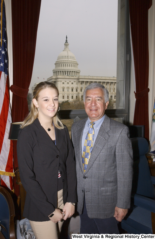 Congressman Rahall stands in his Washington office with a young woman.