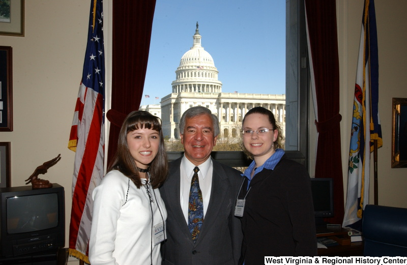 Congressman Rahall stands in his Washington office with two women wearing NYLC badges.