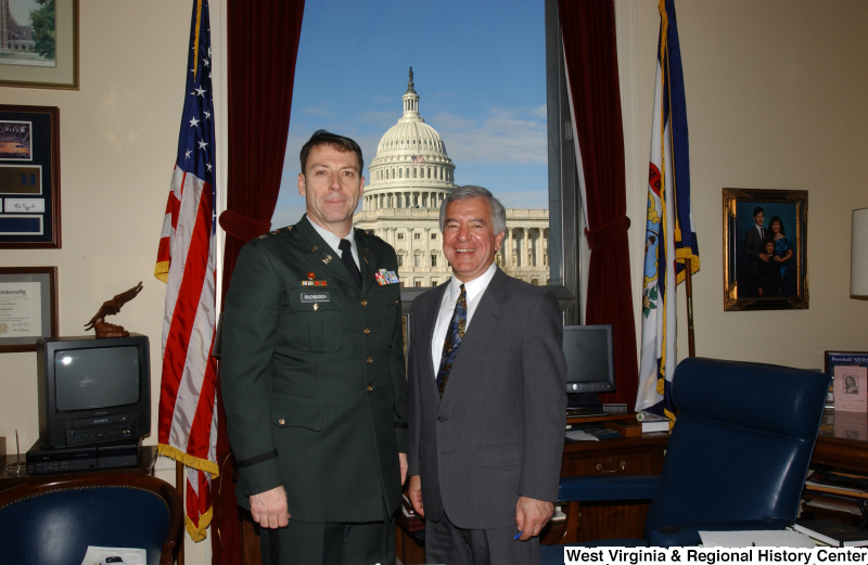 Congressman Rahall stands in his Washington office with Rivenburgh (military officer).