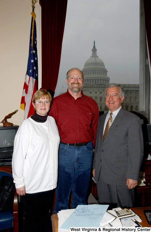Congressman Rahall stands in his Washington office with a man and woman.