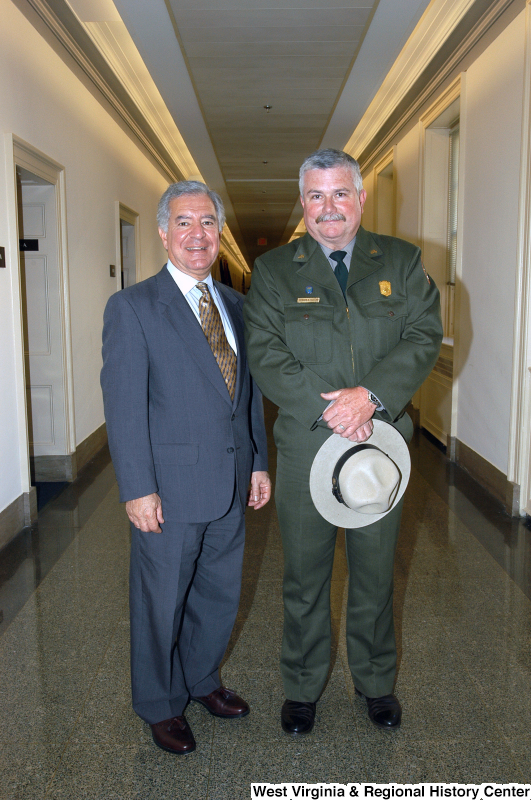 Photograph of Congressman Rahall standing in a hallway with a man from the Park Service