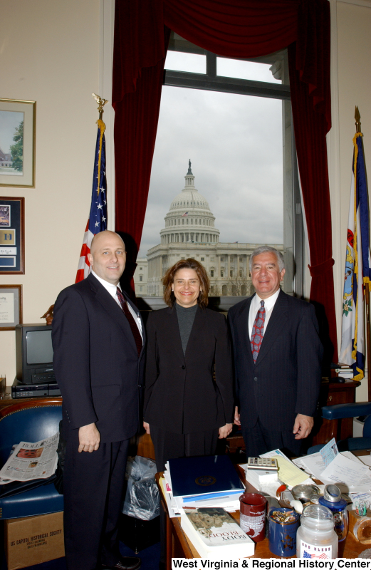 Congressman Rahall stands in his Washington office with a man and a woman.