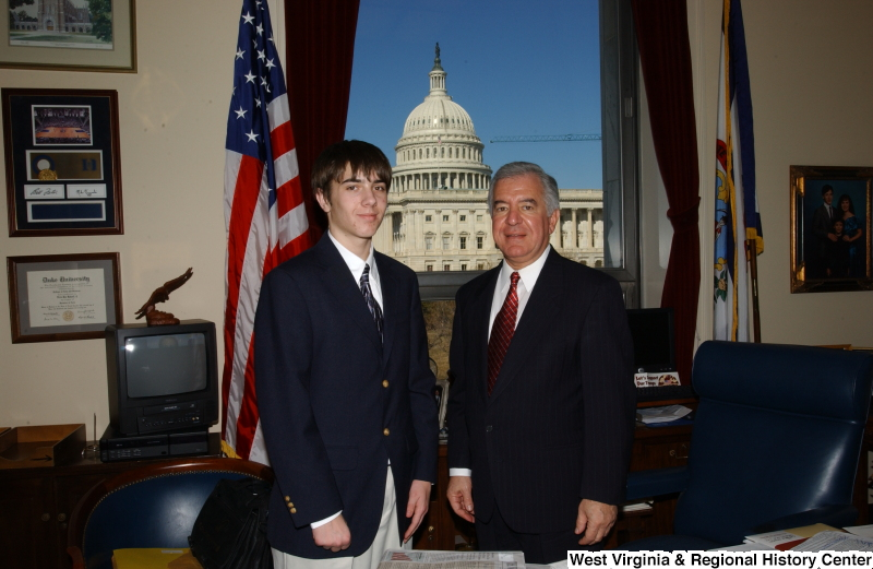 Congressman Rahall stands in his Washington office with a young man wearing a blue blazer.