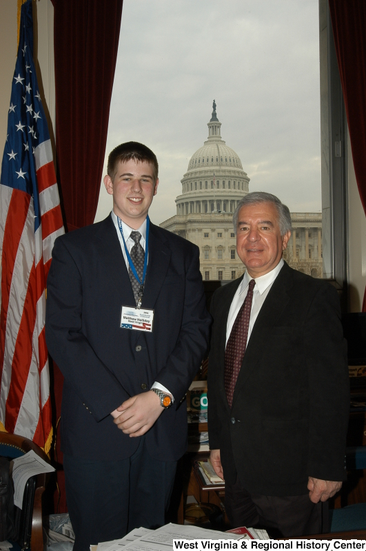 Congressman Rahall stands in his Washington office with Matthew Holliday, 2004 Presidential Classroom