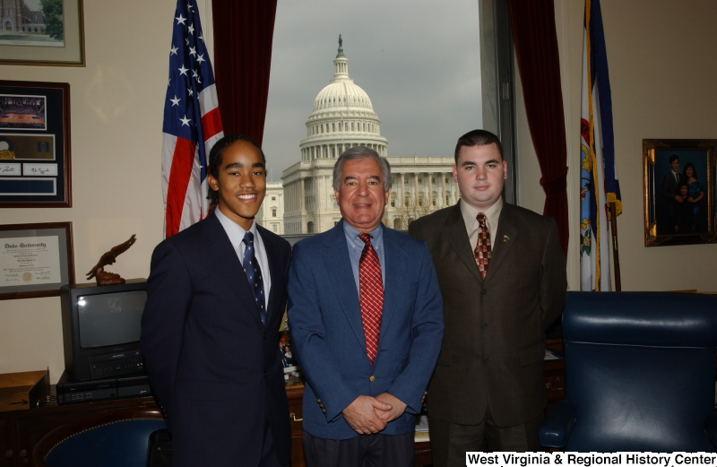 Congressman Rahall stands in his Washington office with two young men.