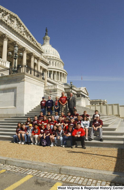 "Congressman Rahall stands on the steps of the Capitol Building with children and some adults wearing ""Alderson"" shirts."