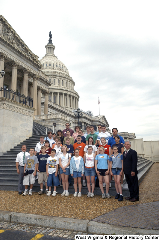 Congressman Rahall stands on the steps of the Capitol Building with a group of children and adults.