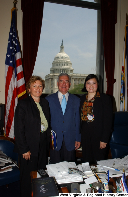 Congressman Rahall stands in his Washington office with two women.