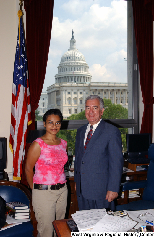 Congressman Rahall stands in his Washington office with a woman wearing a pink shirt.