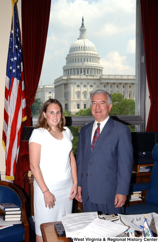 Congressman Rahall stands in his Washington office with a woman wearing a white shirt.