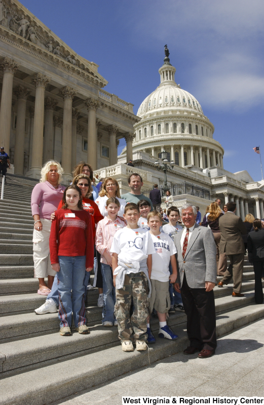 Congressman Rahall stands on the steps of the Capitol Building with six children and five adults.