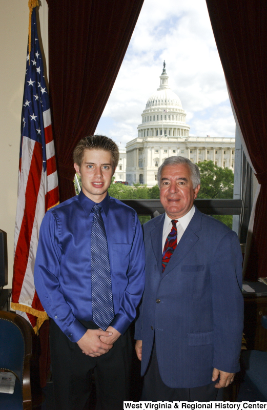 Congressman Rahall stands in his Washington office with a young man wearing a blue shirt.