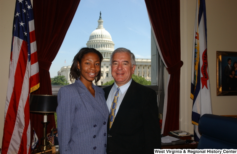 Congressman Rahall stands in his Washington office with a woman wearing a lavender-tinged suit.