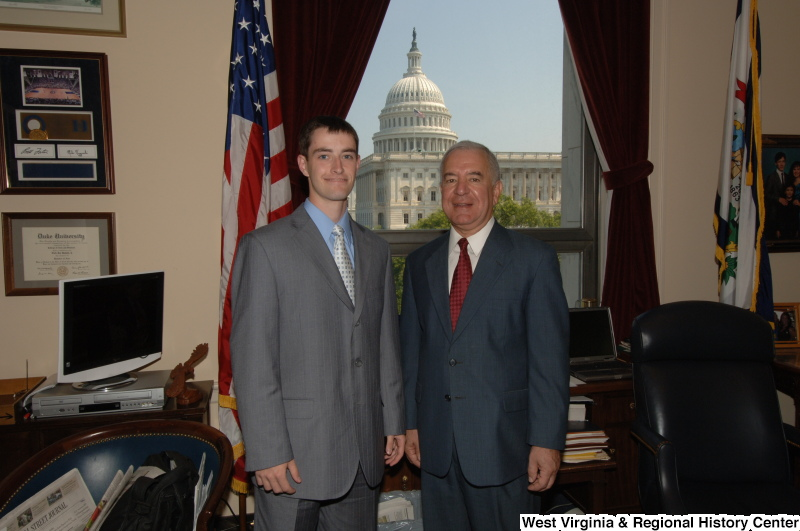 Photograph of Congressman Rahall in his Washington office standing with a man wearing a grey suit and silver tie