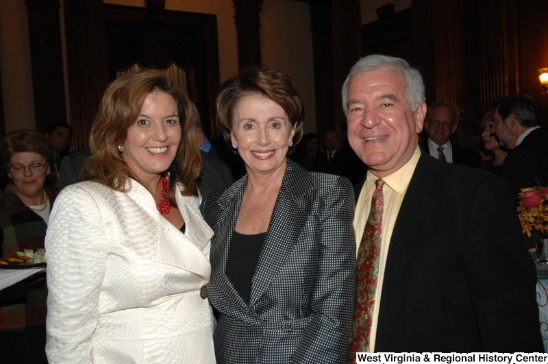 Congressman Rahall stands with Nancy Pelosi and another woman at a reception.