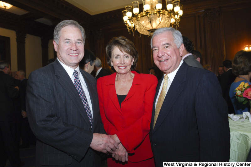 Photograph of Congressman Rahall with Nancy Pelosi and Allan Mollohan at a reception