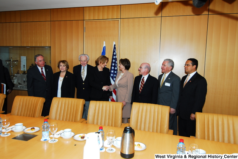 Congressman Rahall, Keith Ellison, Nancy Pelosi, Louise Slaughter, Henry Waxman, and others stand in a conference room during a Congressional Delegation trip to Israel.