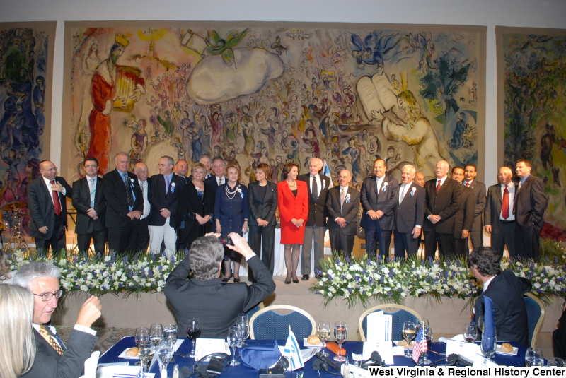 Congressman Rahall, Keith Ellison, Tom Lantos, Nancy Pelosi, Louise Slaughter, Henry Waxman, Robert Wexler, and others stand in front of murals during a Congressional Delegation trip to Israel.