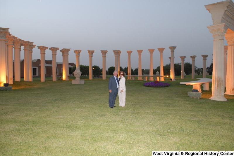 Congressman Rahall stands with a woman amid architectural columns during a Congressional Delegation trip to Saudi Arabia.
