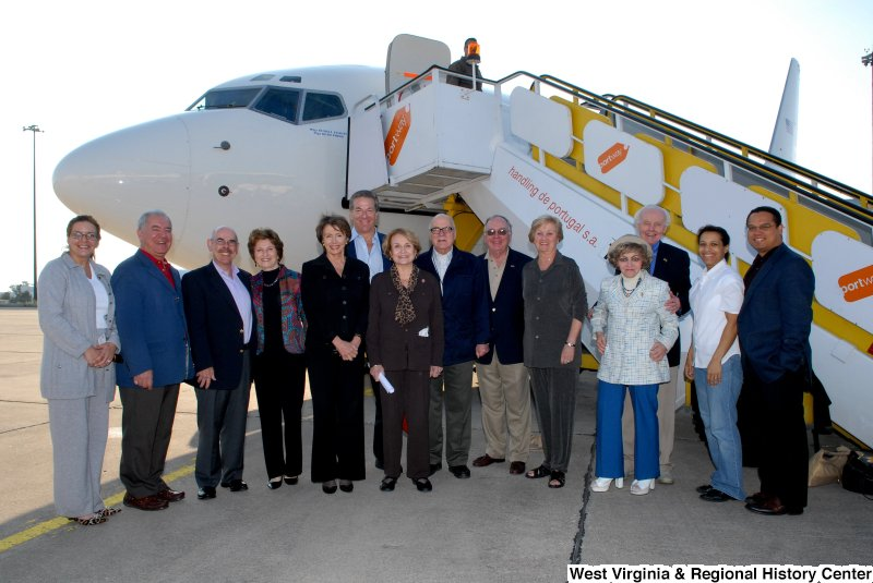 Congressman Rahall, Keith Ellison, Tom Lantos, Nancy Pelosi, Louise Slaughter, Henry Waxman, and others stand next to an airplane during a Congressional Delegation trip.