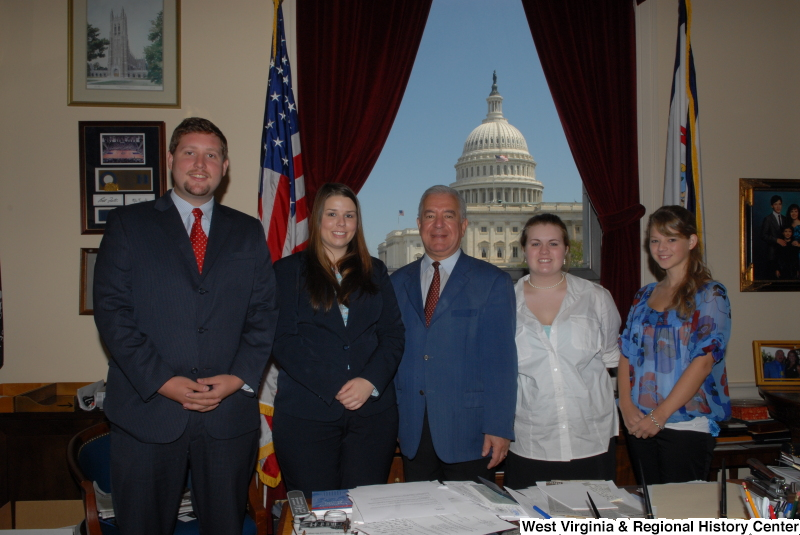 Congressman Rahall stands in his Washington office with a man and three women.
