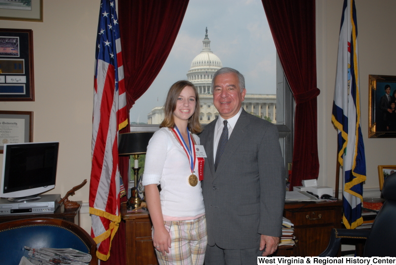 "Congressman Rahall stands in his Washington office with Scott High School student Sarah Dolan, who wears a medal and ""scholar"" ribbon."