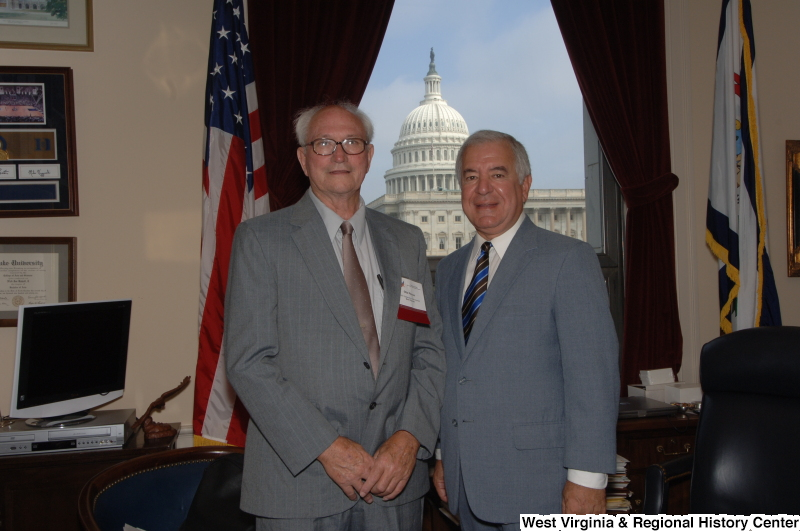 Congressman Rahall stands in his Washington office with Otis Pence.