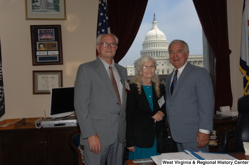 Congressman Rahall stands in his Washington office with Otis and Betty Pence.