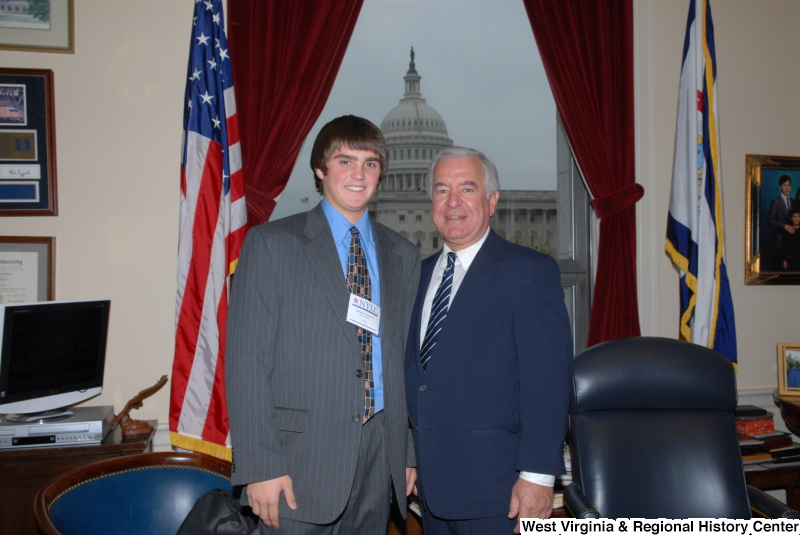 Congressman Rahall stands in his Washington office with a young man from Beckley, West Virginia, wearing a NYLC badge.