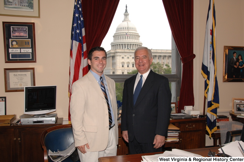 Congressman Rahall stands in his Washington office with a man wearing a tan blazer and striped tie.