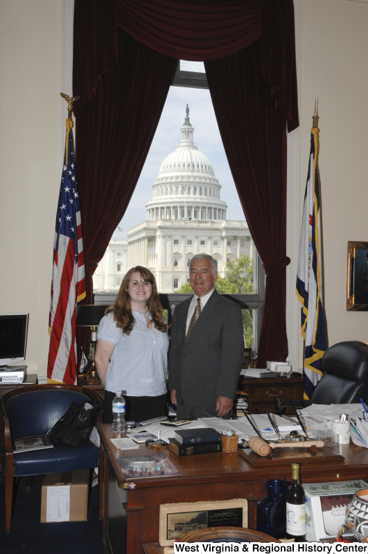 Congressman Rahall stands in his Washington office with a woman wearing a blue-tinged blouse.