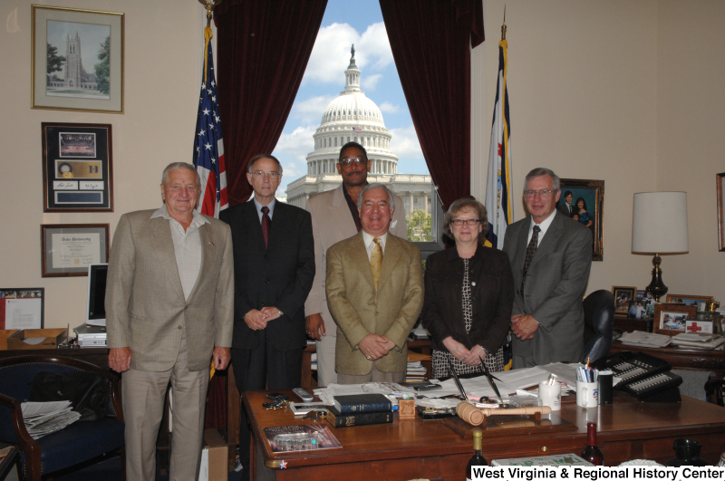 Congressman Rahall stands in his Washington office with four men and a woman.
