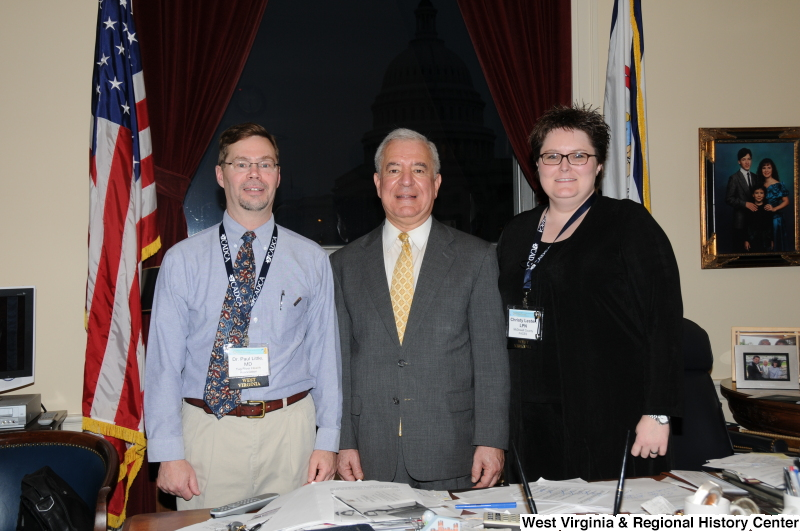 Congressman Rahall stands in his Washington office with Paul Little, M.D., and Christy Lester, LPN.