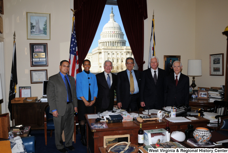 Congressman Rahall stands in his Washington office with four men and one woman.