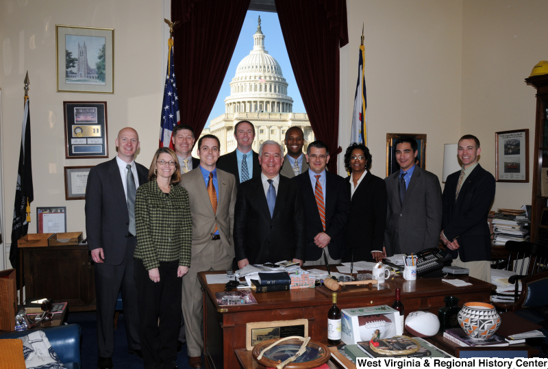 Congressman Rahall stands in his Washington office with ten other people.