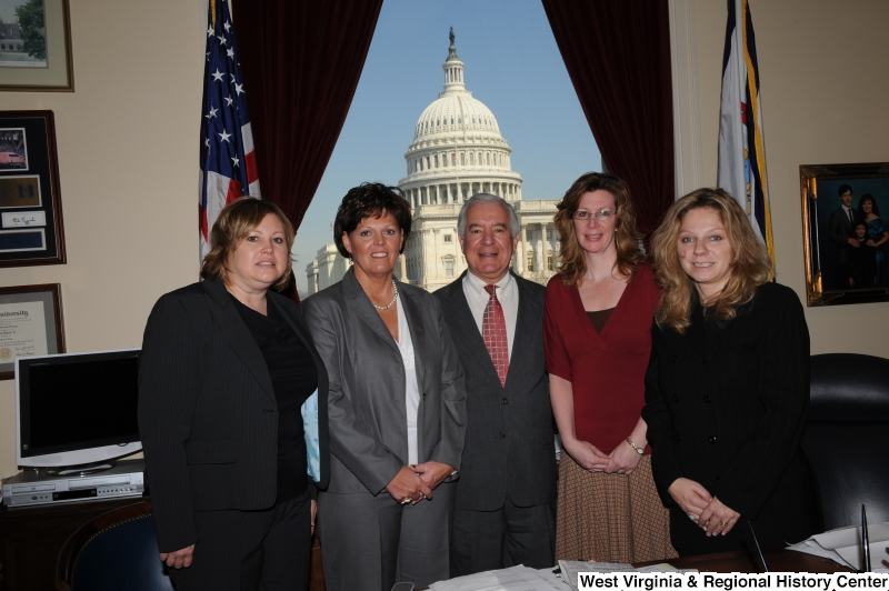Congressman Rahall stands in his Washington office with four women.