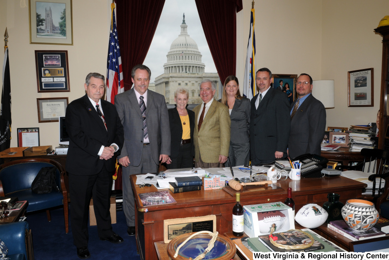 Congressman Rahall stands in his Washington office with four men and two women.