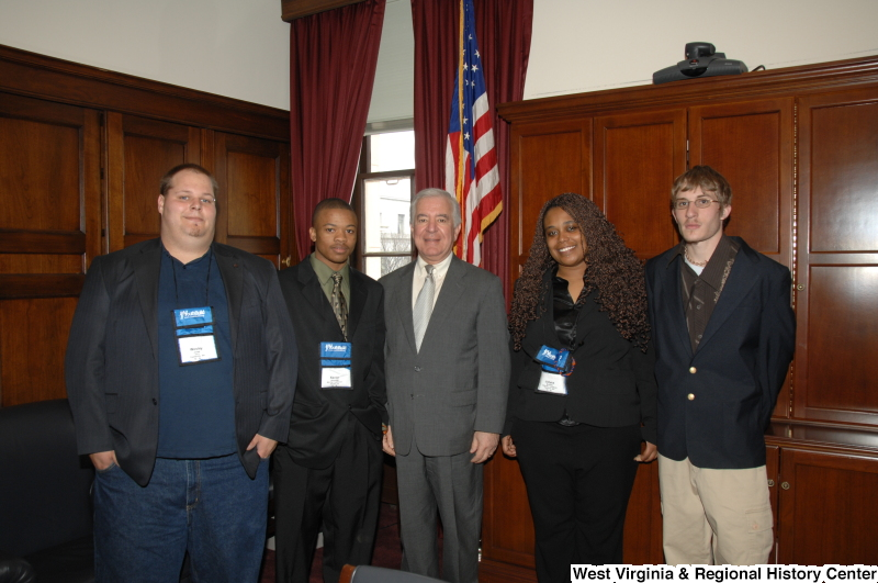 Congressman Rahall stands with four young people wearing YouthBuild name badges.