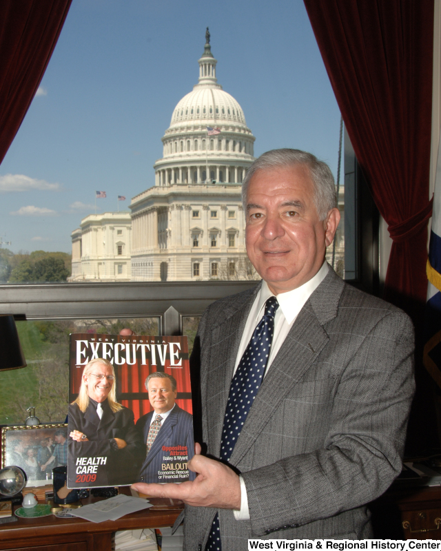 Congressman Rahall in his Washington office holds a copy of West Virginia Executive magazine.