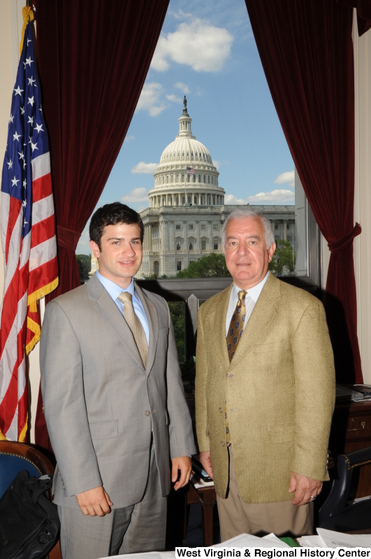 Congressman Rahall stands in his Washington office with a man wearing a light grey suit and gold tie.