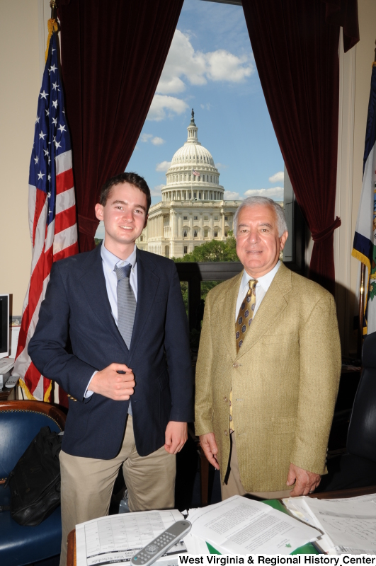 Photograph of Congressman Rahall standing in his Washington office with a man wearing a blue blazer and grey tie