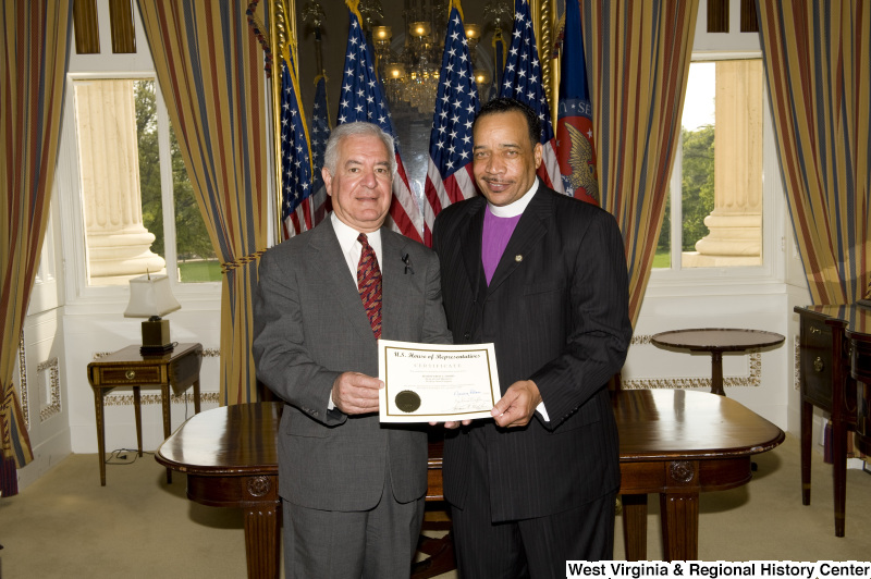Congressman Rahall presents a certificate to Bishop Fred T. Simms, Heart of God Ministries, Beckley, West Virginia.