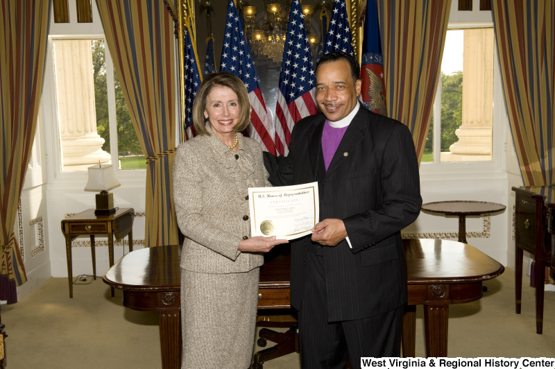 Nancy Pelosi presents a certificate to Bishop Fred T. Simms, Heart of God Ministries, Beckley, West Virginia.